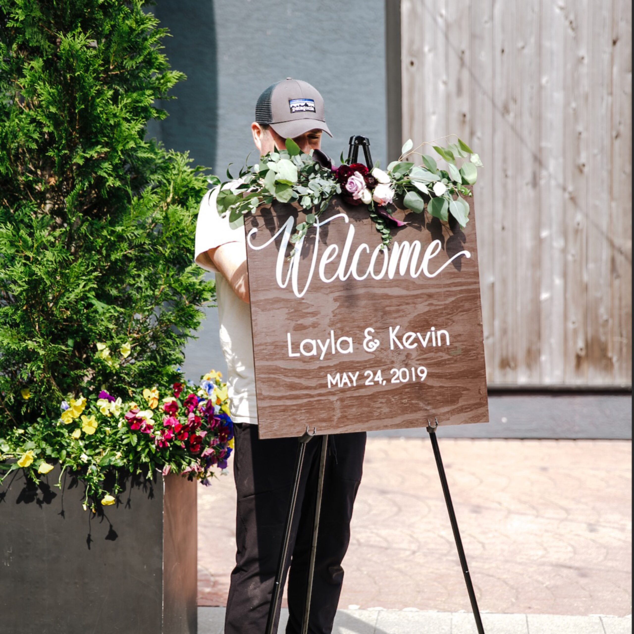 Jonathan installing florals on site for a wedding.